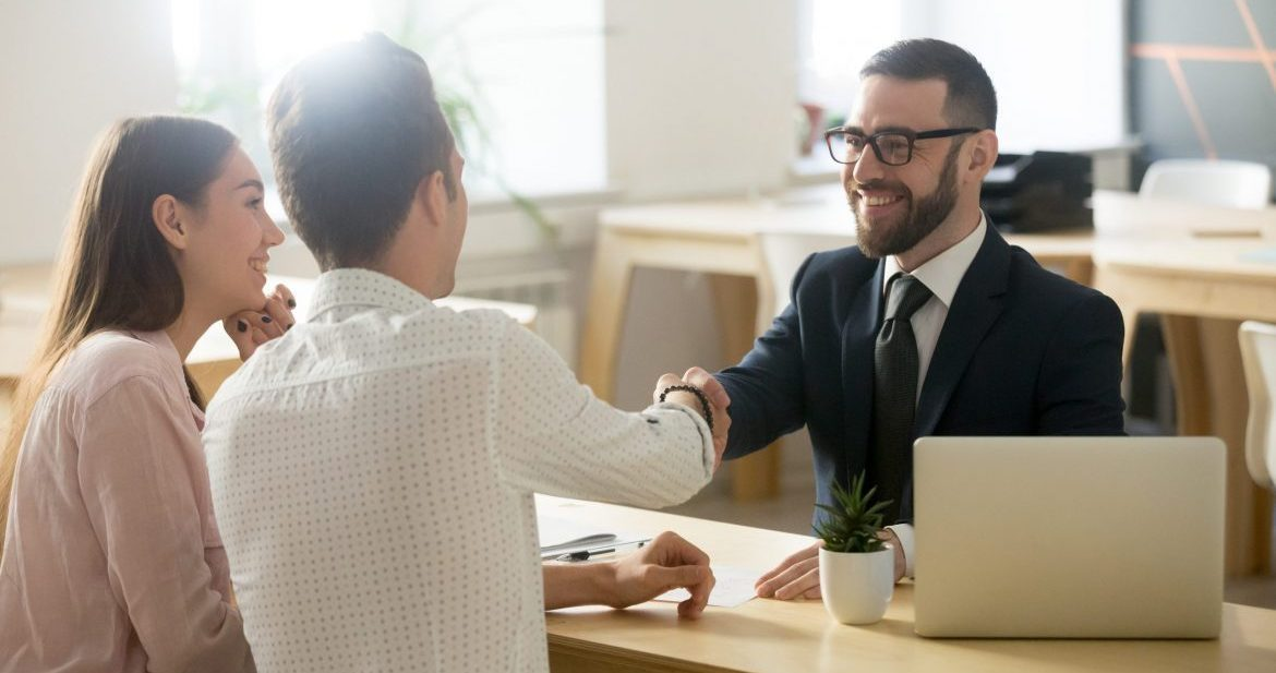 financial services agent shaking hands with customer collaboration